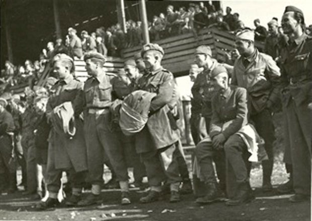 Soliders from Great Britan and Partisans in Maribor(Slovenia) watching together a friendly soccer game